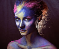 Beauty woman with creative make up like Holy celebration in India Stock Image