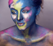 Beauty woman with creative make up like Holy celebration in India Royalty Free Stock Images