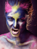 Beauty woman with creative make up like Holy celebration in India Stock Photos