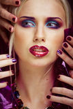Beauty woman with creative make up, many fingers on face Royalty Free Stock Image
