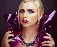 Beauty woman with creative make up, many fingers on face royalty free stock photography