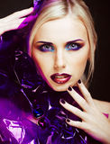 Beauty woman with creative make up, many fingers on face close u Stock Photography