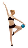 Beauty woman dance with ball in black isolated Stock Images