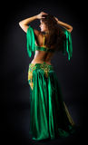 Beauty woman dance in green costume Royalty Free Stock Images