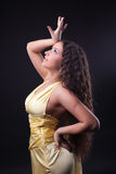Beauty woman dance in yellow cloth Stock Images