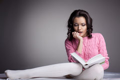Beauty woman in dark read scare book Stock Photo