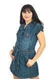 Beauty woman in denim dress Stock Photography