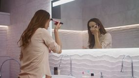 Beauty woman doing makeup in bathroom. Happy woman making morning makeup. stock video