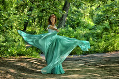 Beauty woman with dress flying Royalty Free Stock Photography