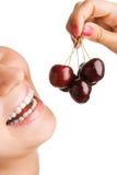 Beauty woman eat cherries stock image
