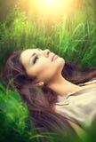 Beauty woman enjoying nature. Beauty woman lying on the field and dreaming. Enjoying nature Royalty Free Stock Photo