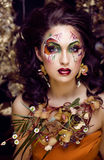Beauty woman with face art and jewelry from flowers orchids Stock Photo