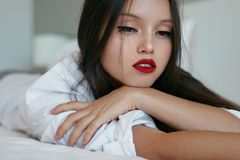 Beauty woman face. Beautiful asian model with red lips makeup stock photography