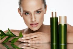 Beauty Woman Face. Beautiful Female With Natural Cosmetics. Beauty Woman Face. Beautiful Female With Natural Organic Cosmetics And Green Leaves On White Royalty Free Stock Photos