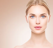 Beauty woman face. Beautiful spa girl with perfect clean skin Stock Photography