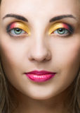 Beauty woman face with bright make-up Stock Image