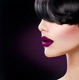 Beauty Woman Face. Close up with Beautiful Dark Violet Lips Royalty Free Stock Image
