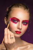 Beauty woman face closeup on black background. Royalty Free Stock Images