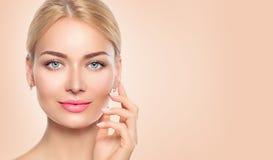 Beauty woman face closeup portrait. Spa girl touching her face stock photos
