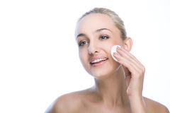 Beauty woman face with cotton pad Royalty Free Stock Image