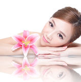 Beauty woman face with flower Stock Photography
