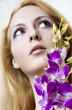 Beauty woman face and flowers closeup Royalty Free Stock Image