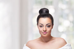 Beauty woman face with half ready make-up Royalty Free Stock Photo