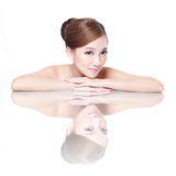 Beauty woman face with mirror reflection Royalty Free Stock Photography