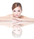 Beauty woman face with mirror reflection Stock Images