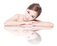 Beauty woman face with mirror reflection Stock Image