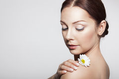 Beauty Woman Face. Perfect Skin. Beautiful Girl With Camomile Flowers.Beauty Woman Face. Perfect Skin. Professional Make-up Royalty Free Stock Images