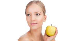 Beauty Woman face Portrait with apple. Skin Care Concept Isolated on a white background stock photography