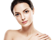 Beauty Woman face Portrait. Beautiful model Girl with Perfect Fresh Clean Skin. Brunette female looking at camera and smiling. Youth and Skin Care Concept royalty free stock photo