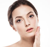 Beauty Woman face Portrait. Beautiful model Girl with Perfect Fresh Clean Skin. Stock Photos