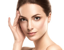 Beauty Woman face Portrait. Beautiful model Girl with Perfect Fresh Clean Skin. Brunette female looking at camera and smiling. Youth and Skin Care Concept royalty free stock photos