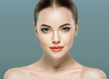 Beauty Woman face Portrait. Beautiful model Girl with Perfect Fresh Clean Skin. Stock Photography