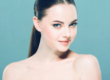Beauty Woman face Portrait. Beautiful Spa model Girl with Perfect Fresh Clean Skin. Blue background. Royalty Free Stock Image