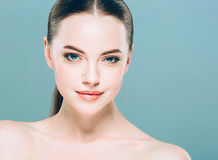 Beauty Woman face Portrait. Beautiful Spa model Girl with Perfect Fresh Clean Skin. Blue background. Stock Photo