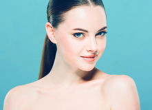 Beauty Woman face Portrait. Beautiful Spa model Girl with Perfect Fresh Clean Skin. Blue background. Royalty Free Stock Photography