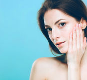 Beauty Woman face Portrait. Beautiful Spa model Girl with Perfect Fresh Clean Skin. Blue background gray Royalty Free Stock Photo