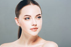 Beauty Woman face Portrait. Beautiful Spa model Girl with Perfect Fresh Clean Skin. Gray background Royalty Free Stock Photo