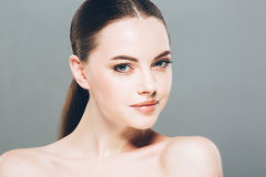 Beauty Woman face Portrait. Beautiful Spa model Girl with Perfect Fresh Clean Skin. Gray background Stock Images