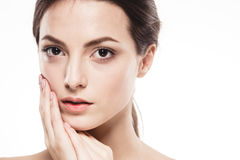 Beauty Woman face Portrait. Beautiful Spa model Girl with Perfect Fresh Clean Skin. Isolated white background Stock Photo