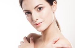 Beauty Woman face Portrait. Beautiful Spa model Girl with Perfect Fresh Clean Skin. Isolated white background Royalty Free Stock Photography