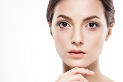 Beauty Woman face Portrait. Beautiful Spa model Girl with Perfect Fresh Clean Skin. Isolated white background Stock Images