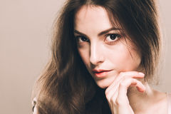 Beauty Woman face Portrait. Beautiful Spa model Girl with Perfect Fresh Clean Skin. Over beige background Stock Photos