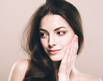 Beauty Woman face Portrait. Beautiful Spa model Girl with Perfect Fresh Clean Skin. Over beige background Stock Photography