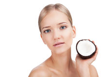 Beauty Woman face Portrait with coconut. Skin Care Concept Isolated on a white background royalty free stock photography