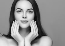 Beauty Woman face Portrait with manicure nails. Beautiful Spa mo royalty free stock photo