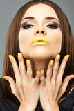 Beauty woman face portrait with yellow lips Royalty Free Stock Image